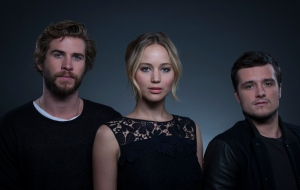 Co-starring in 'The Hunger Games: Mockingjay - Part 1' from left, actors Liam Hemsworth, Jennifer Lawrence and Josh Hutcherson pose for a portrait in New York on Saturday, Nov. 15, 2014. (Invision / Drew Gurian)