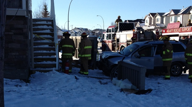 Calgary Fire Department members, including the Heavy Rescue Unit, successfully removed an SUV from the interior of a Martindale home