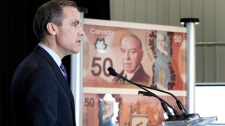 Bank of Canada Governor Mark Carney introduces a new $50 bill made of polymer that has the face of former prime minister William Lyon MacKenzie King and Canadian Coast guard ship Amundsen in Quebec City,  Monday, March 26, 2012. (Jacques Boissinot / THE CANADIAN PRESS)