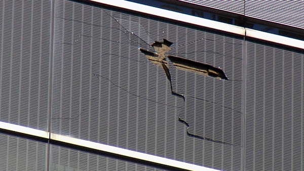A pane of glass is shown after parts of it broke loose and fell from an office tower at 180 Queen St. W. in Toronto on Monday, March 26, 2012.
