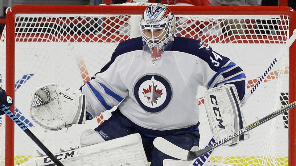 Winnipeg Jets goalie Michael Hutchinson defends the goal during the first period of an NHL hockey game against the Carolina Hurricanes in Raleigh, N.C., Thursday, Nov. 13, 2014. (AP / Gerry Broome)
