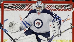 Winnipeg Jets goalie Michael Hutchinson defends the goal during the first period of an NHL hockey game against the Carolina Hurricanes in Raleigh, N.C., Thursday, Nov. 13, 2014. (Gerry Broome/AP)