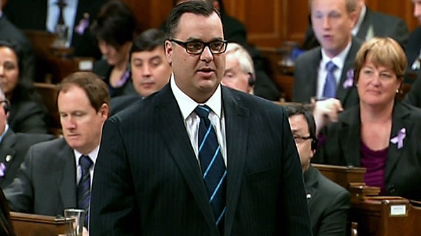 Federal Heritage Minister James Moore responds to a question during question period in the House of Commons in Ottawa, Monday, March 26, 2012.