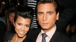 Reality TV stars Kourtney Kardashian and Scott Disick attend the showing of the Jill Stuart spring 2011 collection during Mercedes-Benz fashion week in New York, Saturday, Sept. 11, 2010. (AP / Starpix, Dave Allocca)