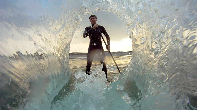 Zach Wilson, of Saskatchewan, paddleboards in North Carolina just before his camera fell into the ocean, only to resurface 10 months later.