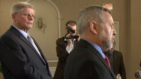 Abbotsford South MLA John van Dongen, right, announces his decision to leave the BC Liberals as BC Conservative leader John Cummins looks on. March 26, 2012. (CTV)