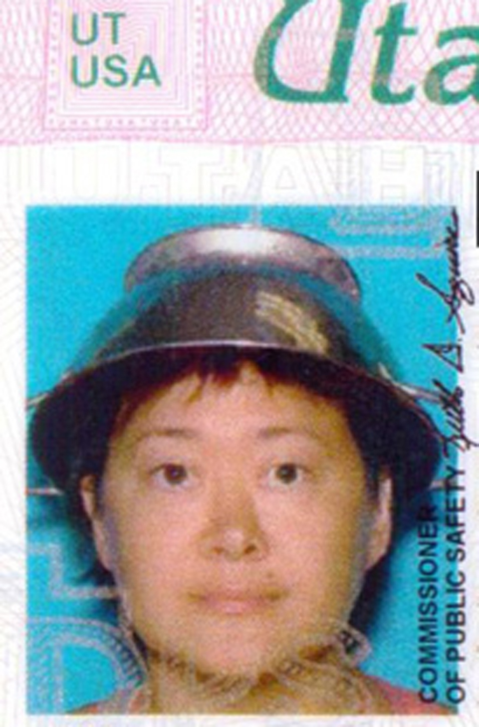 Asia Lemmon, whose legal name appears on her driver's licence as Jessica Steinhauser, is shown wearing a metal colander on her head on her Utah driver's license in this undated photo. (AP Photo/Utah Department of Motor Vehicles via The Spectrum)