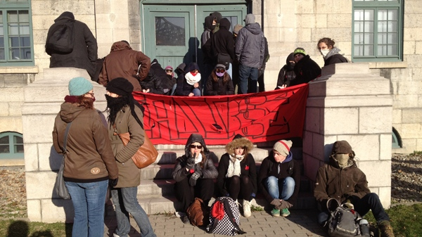 Dozens of students opposed to tuition hikes blocked the doors to the SAQ headquarters on Tuesday morning (March 27, 2012, CTV Montreal/Jean-Luc Boulch)