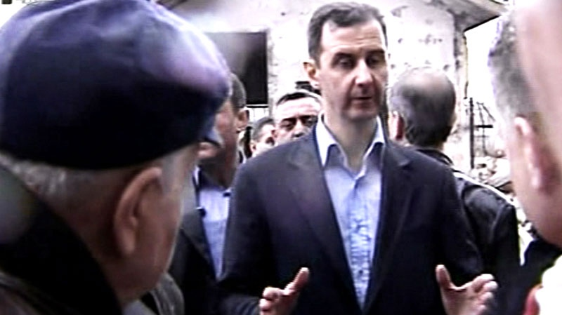 Syrian President Bashar Assad visits Baba Amr neighborhood in Homs, Syria, Tuesday, March 27, 2012.(Syrian State Television via APTN)