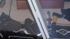 An axe and a blade are seen on the ground at Alvin Wright's home in this undated photo. (CTV)