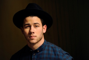 In this Oct. 29, 2014 photo, recording artist and actor Nick Jonas poses for a portrait in Los Angeles to promote his self-titled album, out Nov. 11. (Photo by Chris Pizzello/Invision/AP)