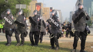 The arrest of Dorian Barton at a G20 protest on June 26, 2010. (THE CANADIAN PRESS / HO)