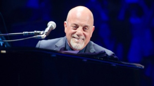 FILE - In this May 9, 2014 file photo, Billy Joel performs at Madison Square Garden in New York. Joel has sold his beachfront mansion on Long Island according to the listing agent, Nancy Mizrahi of Saunders & Associates. Sagaponack is a village in the Town of Southampton in Suffolk County. In 2009, it was listed as the most expensive small village in the U.S.(Photo by Scott Roth/Invision/AP, File)