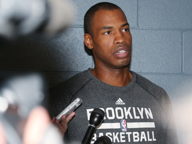 Brooklyn Nets centre Jason Collins considers a question from a reporter before the Nets' game against the Denver Nuggets in Denver on Feb. 27, 2014. (AP / David Zalubowski)