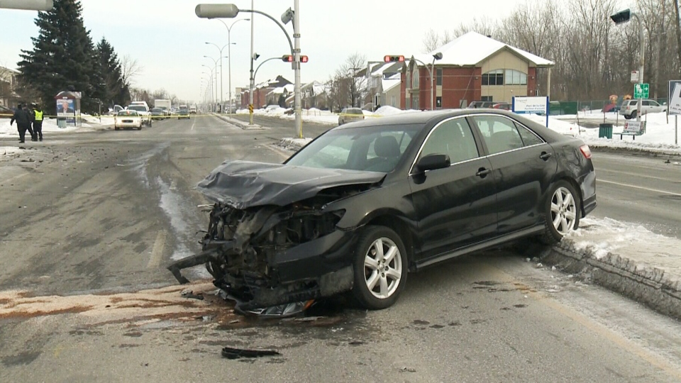 A car is seen following a collision in Longeuil, Que., on Feb. 13, 2014.