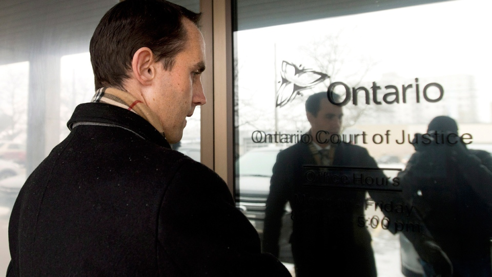 Michael Sona arrives at the Guelph courthouse for his sentencing after being found guilty of election fraud in the so-called robocalls scandal during the 2011 federal election in Guelph, Ont., on Wednesday, Nov. 19, 2014. (Nathan Denette / THE CANADIAN PRESS)