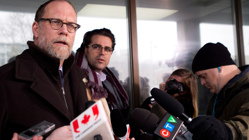 Defence lawyer Norm Boxall, left, speaks to the media regarding the Michael Sona jail sentence received at the Guelph courthouse in Guelph, Ont., on Wednesday, Nov. 19, 2014. (Nathan Denette / THE CANADIAN PRESS)