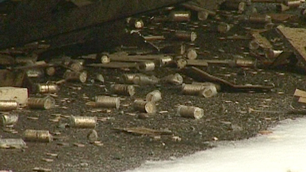 Coins are shown on the ground near the site of a Brinks tractor-trailer crash on Highway 11 north of Kirkland Lake, Ont. on Wednesday, March 28, 2012.