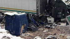 A Brinks tractor-trailer is shown after crashing an spilling millions of coins on Highway 11 north of Kirkland Lake, Ont. on Wednesday, March 28, 2012