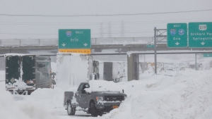Vehicles are piled high with snow on the Thruway between Walden Ave. and Ridge Rd. in Cheektowaga, N.Y., Wednesday, Nov. 19, 2014. (The Buffalo News, Sharon Cantillon)