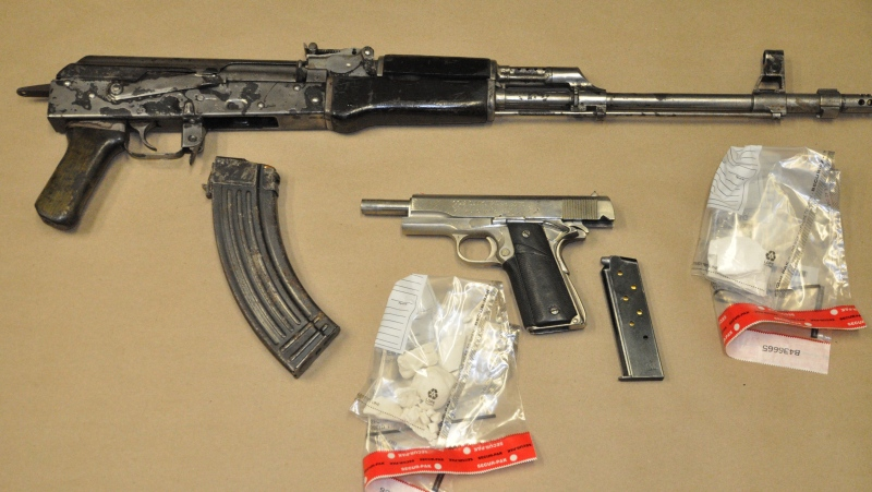 Seized firearms, ammunition and drugs and are seen in this image released by the London Police Service on Thursday, Nov. 20, 2014.