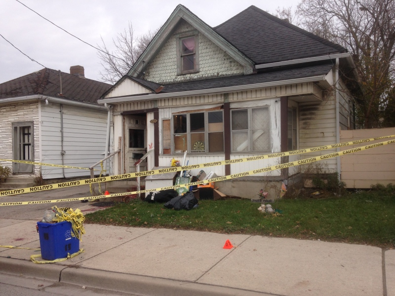 Police tape surrounds a home on Adelaide St. N. where two men were stabbed in London, Ont. on Sunday, Nov. 9, 2014. (Cristina Howorun / CTV London)