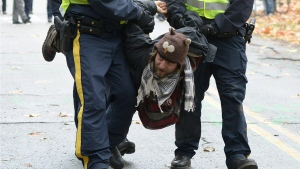 RCMP officers take a protester into custody at an anti-pipeline demonstration in Burnaby, B.C., on Thursday, Nov. 20, 2014. (Jonathan Hayward / THE CANADIAN PRESS)