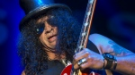 British-American rock guitarist Slash performs on stage featuring Myles Kennedy and The Conspirators in Basel, Switzerland, Saturday Nov. 15, 2014. (Keystone / Georgios Kefalas)