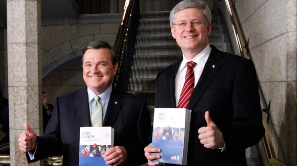 Finance Minister Jim Flaherty and Prime Minister Stephen Harper make their way to the House of Commons to deliver the federal budget on Parliament Hill in Ottawa on Thursday March 29, 2011. (Fred Chartrand / THE CANADIAN PRESS)