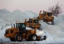 Heavy equipment moves snow in Buffalo