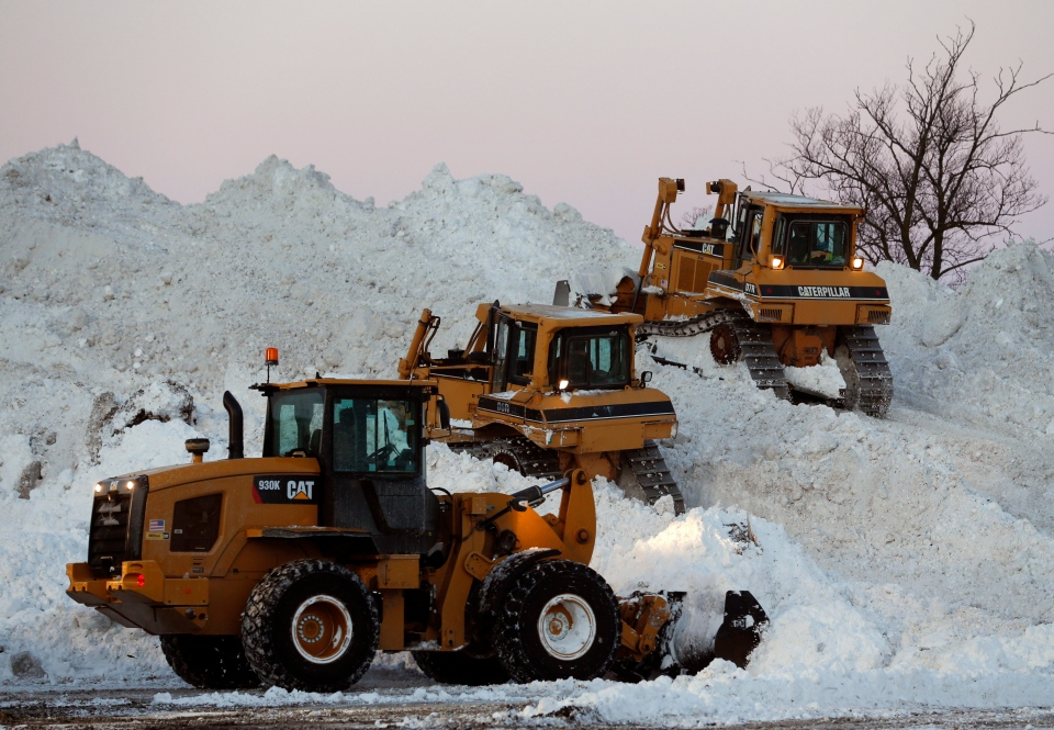 Heavy equipment moves snow at the Central Terminal that was removed from south Buffalo neighborhoods after heavy lake-effect snowstorms on Friday, Nov. 21, 2014, in Buffalo, N.Y. (AP / Mike Groll)
