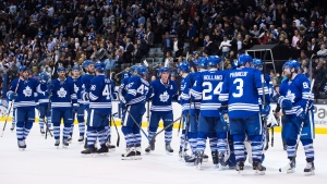 The Toronto Maple Leafs celebrate their 5-2 victory over the Tampa Bay Lightning during NHL hockey action in Toronto on Thursday, Nov.20, 2014. (Darren Calabrese / THE CANADIAN PRESS)