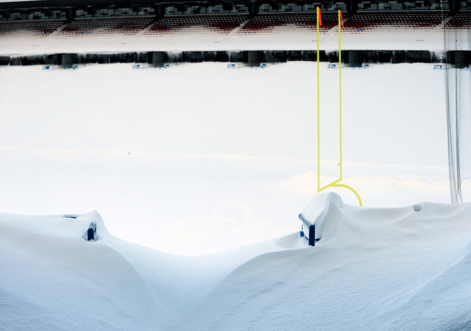 An aisle is drifted over and seats are filled with snow at Ralph Wilson Stadium in Orchard Park, N.Y. Friday, Nov. 21, 2014. (AP / Gary Wiepert)