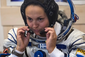 In this Sept. 25, 2014 photo, Russian cosmonaut Elena Serova, the crew member of the mission to the International Space Station, ISS, attends pre-launch preparations at the Russian leased Baikonur cosmodrome, Kazakhstan. AP Photo/Pavel Golovkin, File)