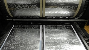 Braille printing plates at the Associated Services for the Blind offices in Philadelphia. (AP / Sharon Gekoski-Kimmel)