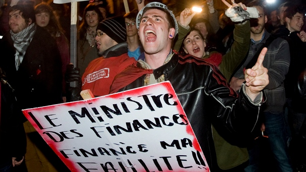 Students opposing tuition fee hikes protest outside Quebec Premier Jean Charest's house in Montreal on Wednesday March 28, 2012. THE CANADIAN PRESS/Graham Hughes