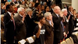 Members of a 16-member Ferguson Commission are sworn in by Missouri Gov. Jay Nixon on Nov. 18, 2014, in St. Louis. (AP / Jeff Roberson)