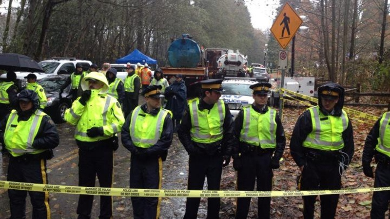 Kinder Morgan equipment behind police lines on Burnaby Mountain on Nov. 21, 2014. (CTV/Jon Woodward)