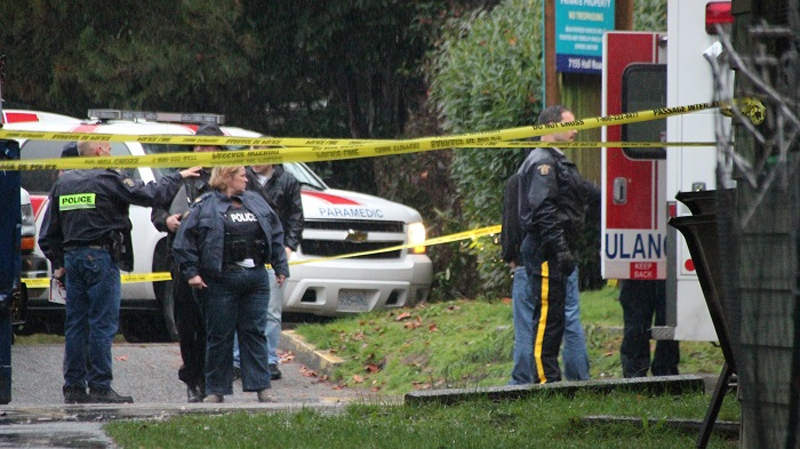 Mounties gather at the scene of an officer-involved shooting in Surrey on Friday, Nov. 21, 2014. (CTV)