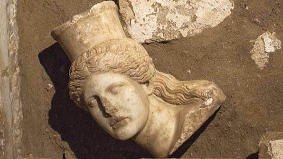 The broken-off head of a marble sphinx, one of a pair that decorated the entrance of a large 4th century B.C. tomb under excavation at Amphipolis in northern Greece. (AP / Greek Culture Ministry)