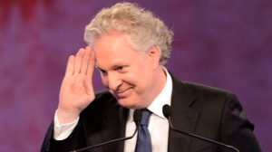 Former Quebec premier Jean Charest waves to the crowd as the Quebec Liberal Party holds a tribute in his honour Saturday, March 16, 2013 at the leadership convention in Montreal. THE CANADIAN PRESS/Ryan Remiorz