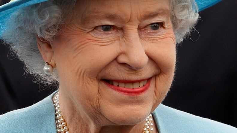 The Queen smiles as she greets local dignitaries at Waltham Forest Town Hall, as part of the Queen's Diamond Jubilee regional tour, in north east London, Thursday, March, 29, 2012. (AP / Alastair Grant)
