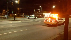 Police cordon off the intersection of East 41st and Knight streets in East Vancouver after an officer was involved in a shooting that sent one person to hospital. Nov. 22, 2014. (CTV)