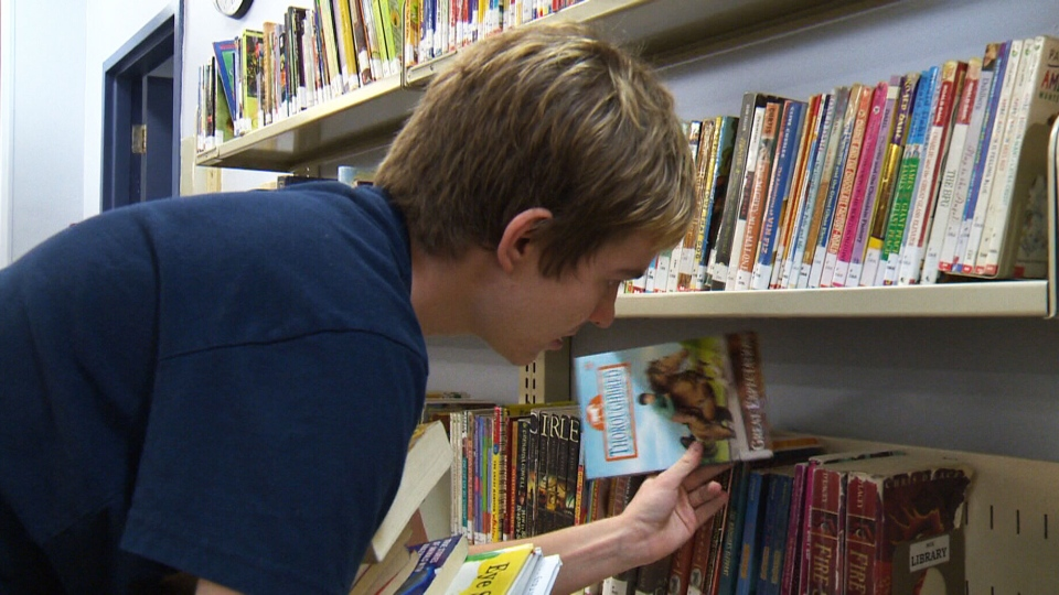 Jaden Lake, 19, was diagnosed with autism when he was two and now volunteers at a school library in Edmonton stocking shelves, cataloguing, labelling and working with computers.
