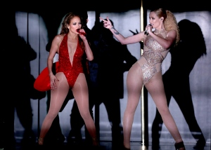 Jennifer Lopez, left, and Iggy Azalea perform at the 42nd annual American Music Awards at Nokia Theatre L.A. Live on Sunday, Nov. 23, 2014, in Los Angeles. (Invision /  Matt Sayles)