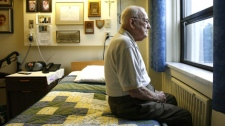 Jean-Marie Cloutier, 83, of Ottawa looks out his room window at his nursing home in Ottawa on Saturday, June 28, 2008. (Sean Kilpatrick / THE CANADIAN PRESS)