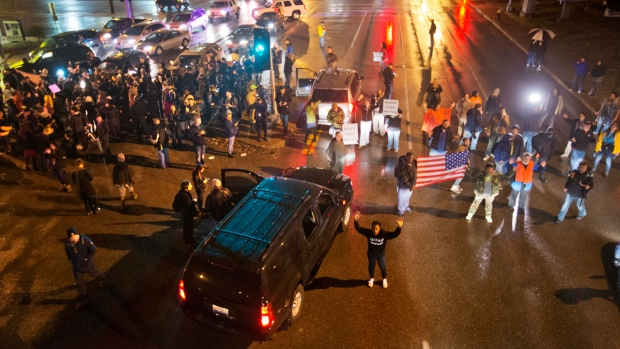 Demonstrators block a busy intersection while marching through the streets to protest the August shooting of Michael Brown, Sunday, Nov. 23, 2014, in St. Louis. (AP / David Goldman)