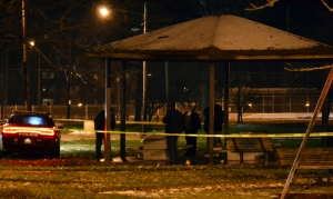 This Nov. 22, 2014 photo shows Cleveland police investigating a scene after an officer fired two shots, killing 12-year-old Tamir E. Rice, who police said pulled a gun from his waistband. (AP Photo/Northeast Ohio Media Group, Cory Schaffer)