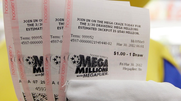 Mega Millions Lottery tickets that were given away to the first 540 people are displayed by the Hoosier Lottery's Mega Millions mascot at a store in Zionsville, Ind., Friday, March 30, 2012. (AP / Michael Conroy)