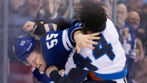 Toronto Maple Leafs' Korbinian Holzer (left) and Winnipeg Jets' Zach Bogosian trade blows during period NHL hockey action in Toronto on Saturday, March 16, 2013. (Chris Young / THE CANADIAN PRESS)